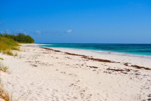 Acklins beach, sunny skies with long strip of untouched sandy beaches and clear, turquoise water