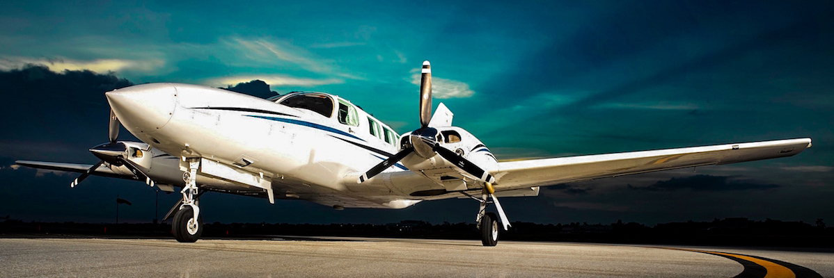 Photo of white and blue private charter airplane for lease to Bahamas Marsh Harbour North Eleuthera Harbour Island Treasure Cay Chub Cay Staniel Cay Governor's Harbour Discount Price Airline Airfare Best Price Guaranteed Private Air Jet Charter